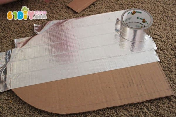 Cardboard making shields and swords