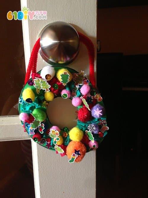 Little child making beautiful Christmas wreath