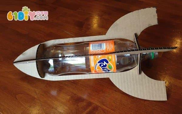 Beverage bottle waste cardboard making rocket model