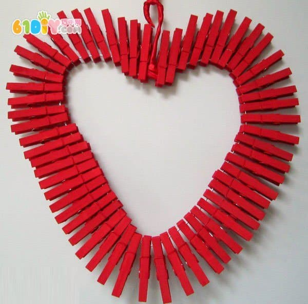 Wooden clothespins make Valentine's Day love