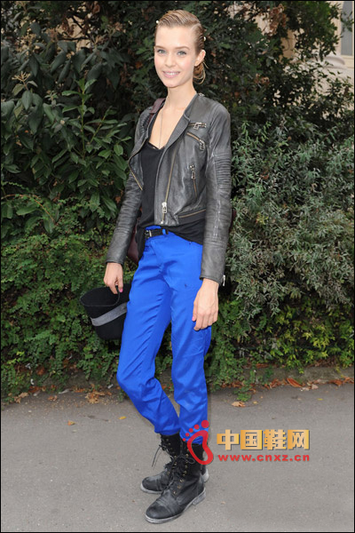 Handsome leather jacket with high waist slacks and Martin boots
