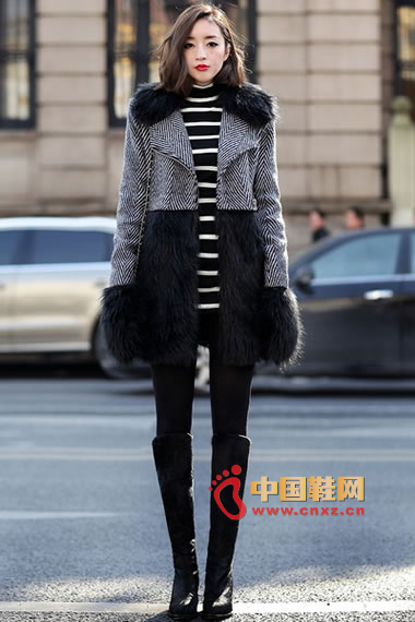 Stitching black fur coat, lined with black and white sweater, black leggings, black high-heeled boots