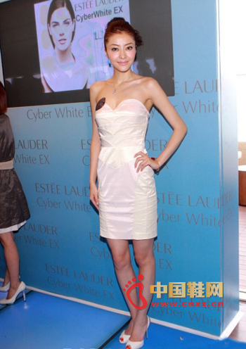 A well-trimmed white tube top dress, no extra embellishment, but not monotonous
