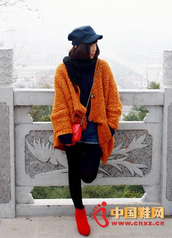 Orange loose knit jacket + hole denim shorts + red boots