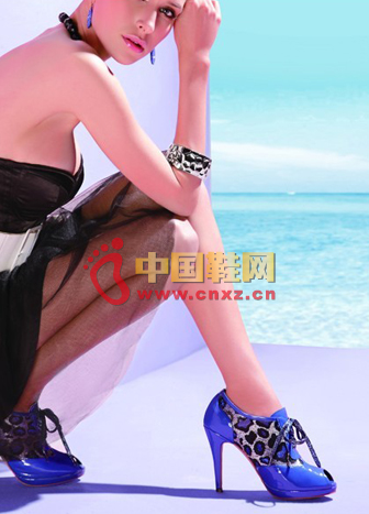 Bright blue fish mouth high heels with leopard stripes against each other, full of wild feminine