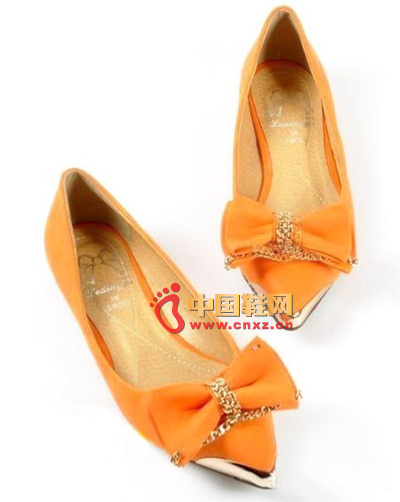 Classic orange-colored pretty bow, full of laid-back elegance