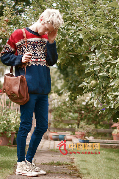 Simple dark blue sweater with classic snow pattern and red shoulder background