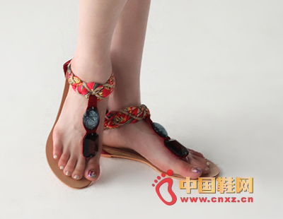 A stylish Roman-style sandal with a mix of ethnic styles, especially the beaded design