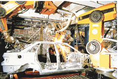 Figure 1 Industrial robots operating on the production line