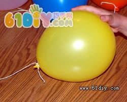 Balloon making pumpkin lantern