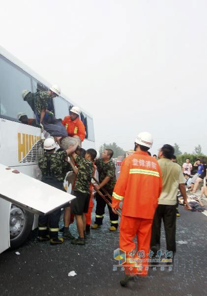 Rescue workers rescue trapped passengers from passenger cars