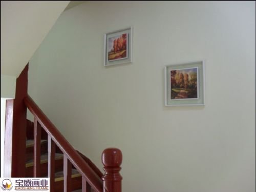 Staircase aisle with paintings