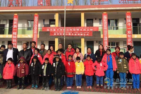 Xikang staff posing with children