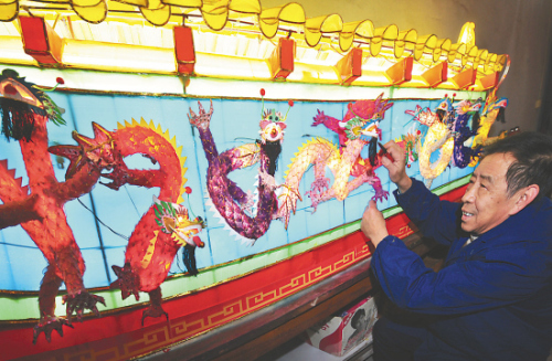 """Nine Dragons in Kowloon"" completed lighting of large wall lanterns"
