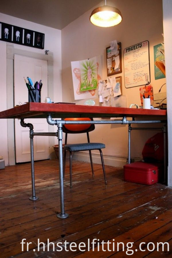 diy-desk-of-salvaged-door-and-pipes