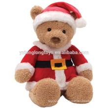 Neue Ankunft braune sitzende Bär, die Weihnachtskleidung trägt