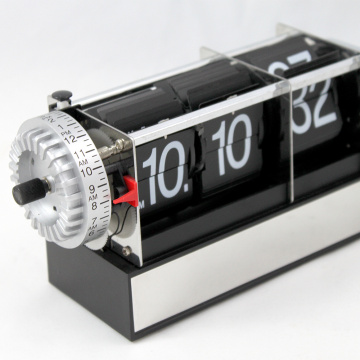 Black Flip Alarm Clock With A Cubic Foundation