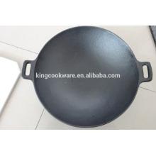 fonte de wok de cuisson en fonte au wok de Chine revêtue d'un pré-assaisonnement pour la cuisine