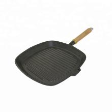 Plaque de cuisson en fonte avec poignée amovible