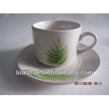 Haonai exportado verde hierba taza de cerámica y platillo