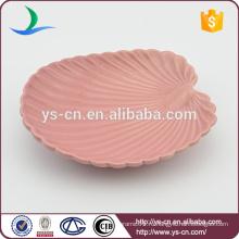 Керамическая посуда из морской ракушки
