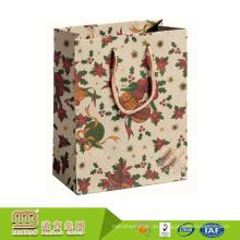 Compras promocionales de lujo al por mayor personalizadas su propio bolso de papel de Kraft del logotipo con la manija de la cuerda