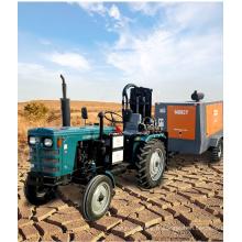 Installation de forage de puits d'eau montée sur tracteur