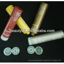 Round colored cosmetic packaging tube for sunblock lotion
