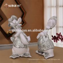 Hot-selling nouveau design Artificial sculpté Résine Crafts Statue de canard debout Figurine de canard paisible argentée Décoration intérieure