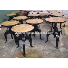 Table à manivelle industrielle Table à mangue en bois Arbre en rond en alliage encadré