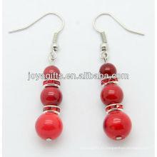 Boucles d'oreilles en corail rouge avec perles en alliage rouge
