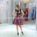 Las mujeres del fabricante del OEM vestidos de noche de moda forman un vestido plisado de llamarada corta