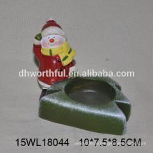 Sostenedor de vela de cerámica de las ventas directas de la fábrica en forma del muñeco de nieve para la decoración casera