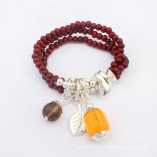 Los granos calientes de la resina de la venta envuelven las pulseras al por mayor del rosario