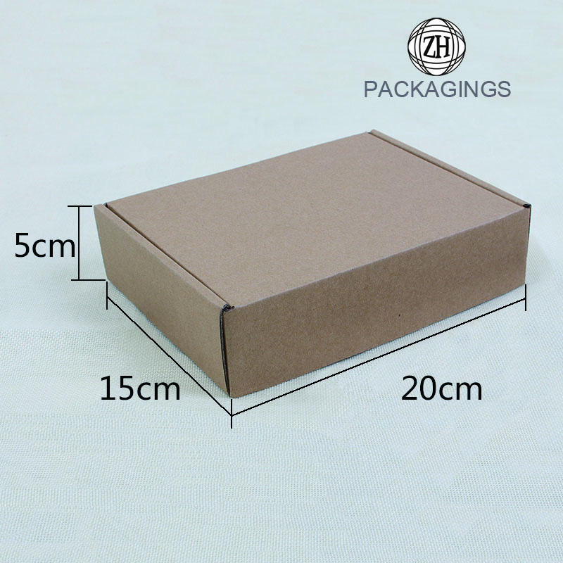Small brown corrugated paper shipping boxes