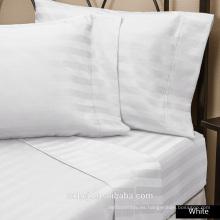 Fábrica al por mayor 100% de algodón Natural raya blanca hotel cama king size ropa de cama