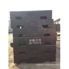1000 kg de poids de fer