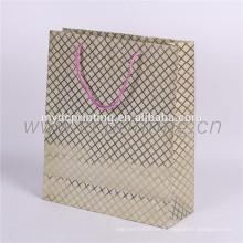 Precio barato de papel de oro de regalo promocional bolsa de papel de lujo
