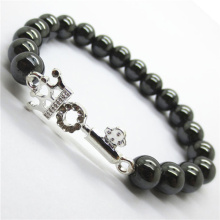 Hematite 8MM Round Beads Stretch Gemstone Bracelet with alloy key Piece