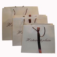Papiereinkaufstasche mit Band und Logo