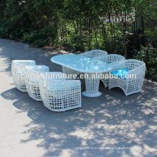 A mesa de jantar exterior da mobília redonda branca nova do Rattan ajustou-se para 6