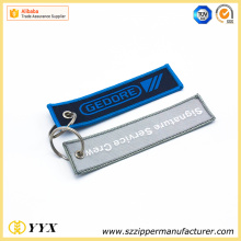 Embroided remove before flight airline key ring