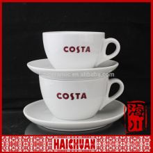 HCC giant cup and saucer, gold rim tea cup and saucer