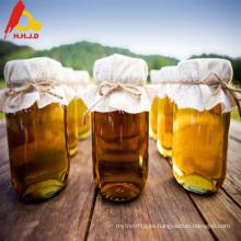 Miel real dorada fresca sin procesar