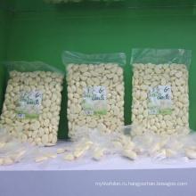 Свежий очищенный зубчик чеснока в мешке 1 кг