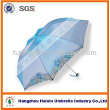 Hermoso sol y lluvia mujeres paraguas