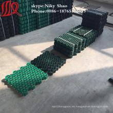 Pavimentadora de césped con techo de rejilla de plástico
