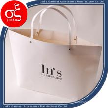 Bolsos de compras impresos baratos de la ropa de papel del logotipo de los bolsos de compras