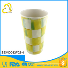 OEM customized yellow and white grid snack and cold drink cup