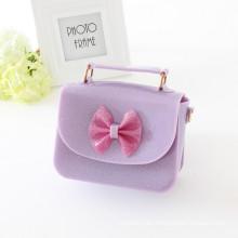 Nuevo bolso de la jalea diseñada bolsos de la jeringuilla de la muchacha del bolso de los niños con los bownots de la fábrica china